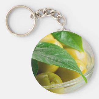 Chaveiro Ideia macro das azeitonas com folhas verdes