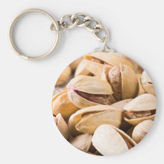 Chaveiro Ideia macro do fim-acima de um grupo de pistachio