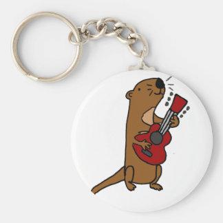 Chaveiro Lontra de mar engraçada que joga a guitarra
