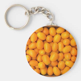 Chaveiro Montão de kumquats alaranjados na caixa de cartão