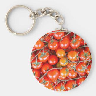 Chaveiro Muitos grupos de tomates vermelhos da videira