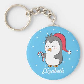 Chaveiro O bastão de doces bonito do pinguim do Natal caçoa