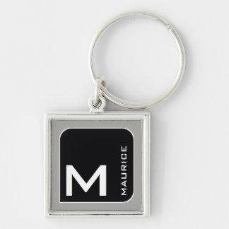 Chaveiro para ele um preto moderno. monograma do logotipo