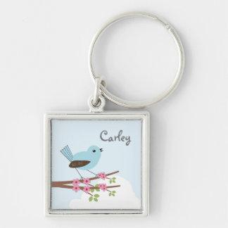 Chaveiro Pássaro azul na árvore da flor