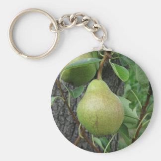 Chaveiro Peras verdes que penduram em uma árvore de pera
