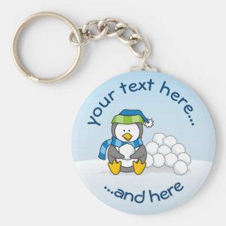 Chaveiro Pinguim pequeno que senta-se com snowballs