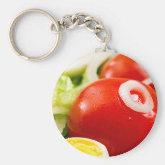 Chaveiro Tomates e ovos cozidos de cereja em uma salada