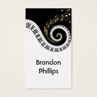 Chaves do piano e notas da música do ouro cartão de visitas
