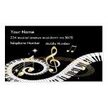 Chaves do piano e notas douradas da música cartao de visita
