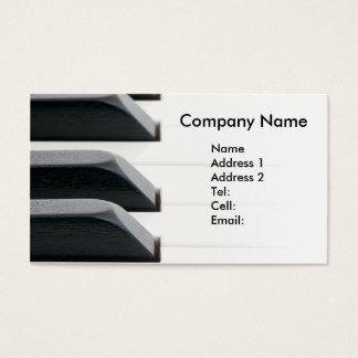 Chaves do piano que desvanecem-se ao branco cartão de visitas