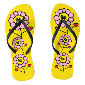 Chinelos amarelos brilhantes das flores
