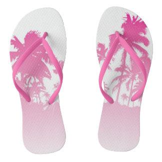 Chinelos cor-de-rosa das palmas