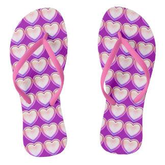 Chinelos cor-de-rosa do teste padrão dos corações