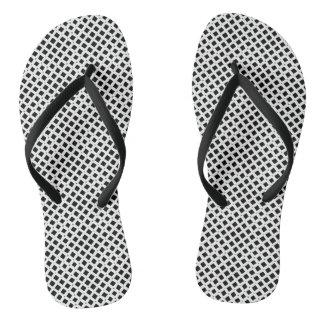 Chinelos preto e branco do teste padrão do