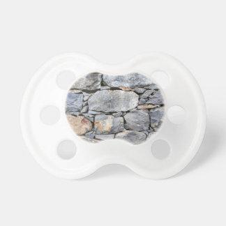 Chupeta Backgound de pedras naturais como a parede