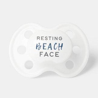Chupeta Cara de descanso da praia