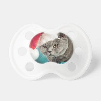 Chupeta Natal cinzento do gato - gato do Natal - gato do