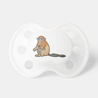 Chupeta O ouro Desprezo-Cheirou o macaco