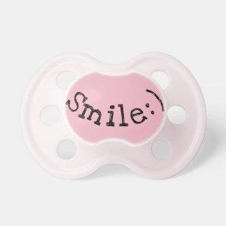 Chupeta Pacifier cor-de-rosa com sorriso