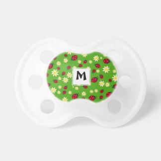 Chupeta verde bonito do teste padrão de flor do joaninha e
