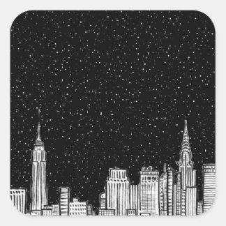 Cidade na noite, etiqueta do resíduo metálico do