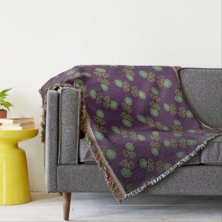 Cobertor Cobertura à franjas com flor sobre púrpero