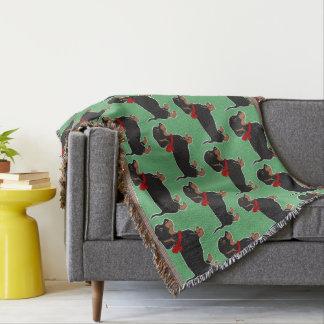 Cobertor Dachshunds com a cobertura vermelha do lance do
