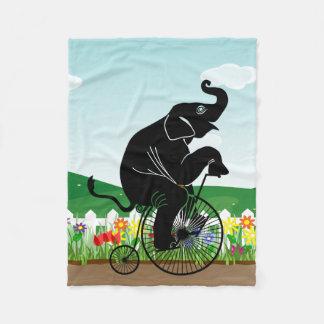 Cobertor De Velo Elefante que monta uma bicicleta