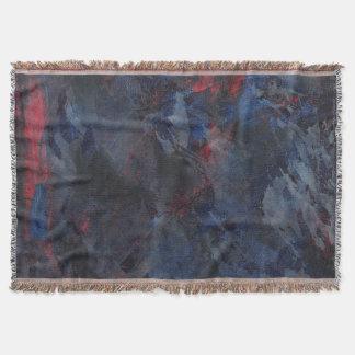 Cobertor Preto e branco no fundo azul e vermelho