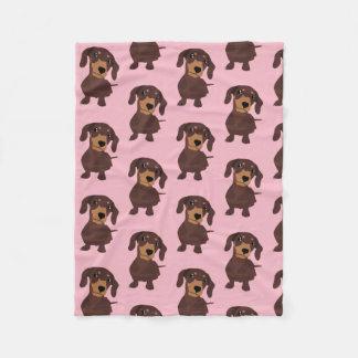 Cobertura bonito do rosa do filhote de cachorro do cobertor de velo