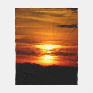 Cobertura vermelha do por do sol cobertor de velo