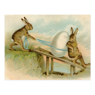 Coelhos e ovo antigos velhos do felz pascoa do cartão postal