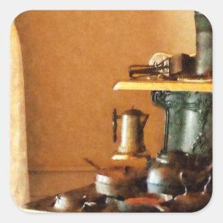 Coffeepot no fogão adesivo quadrado