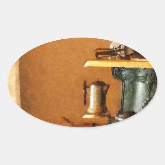 Coffeepot no fogão adesivos ovais