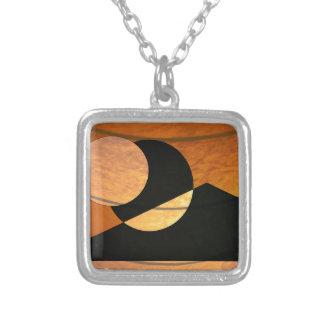 Colar Banhado A Prata Fulgor dos planetas, preto e cobre, design gráfico