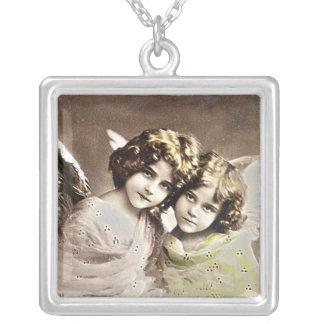 Colar pequena da foto das irmãs do anjo