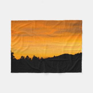 Colinas da pradaria na fotografia do por do sol cobertor de velo