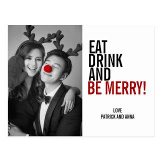Coma a bebida e seja cartão da foto do Feliz Natal