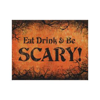 Coma a bebida e seja decoração assustador do Dia