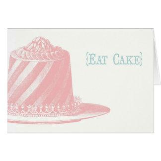 Coma o cartão de aniversário do bolo