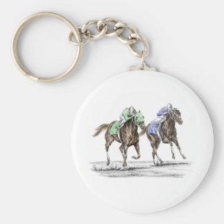 Competência de cavalos do puro-sangue chaveiros