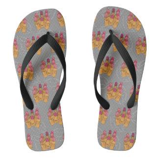 Composição da disposição do batom em chinelos