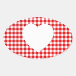 Coração branco no guingão vermelho adesivo oval