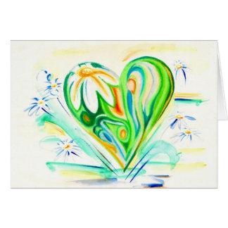Coração da flor e cartão verdes das margaridas