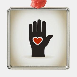 Coração em uma mão ornamento de metal