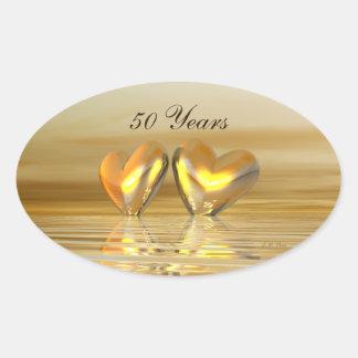 Corações dourados do aniversário adesivo oval