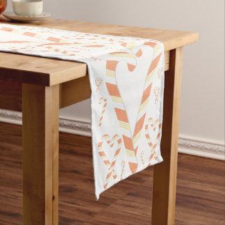 Corredor alaranjado da mesa do bastão de doces do caminho de mesa pequeno