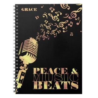 Costume, ouro, paz e música caderno