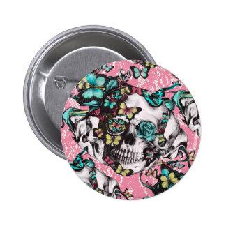 Crânio cor-de-rosa da borboleta no laço cor-de-ros pins
