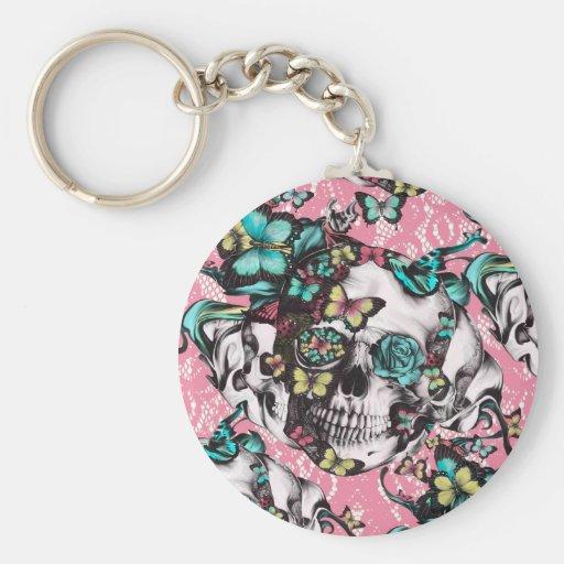 Crânio cor-de-rosa da borboleta no laço cor-de-ros chaveiro